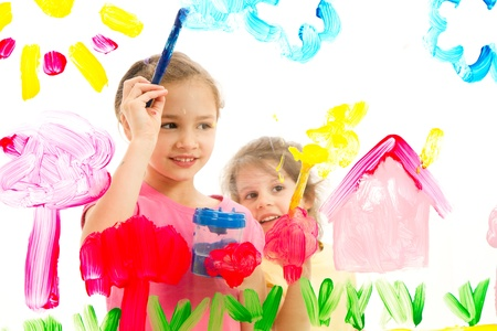 Children painting artwork on glass  Isolated on white  Stock Photo