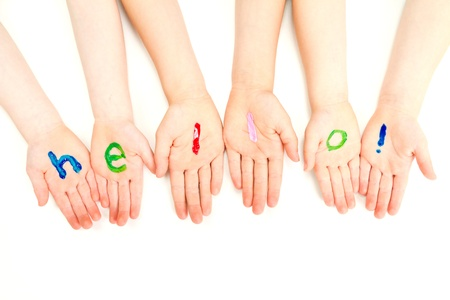 talk to the hand: Kids hands with hello welcome painted on them  On white  Stock Photo