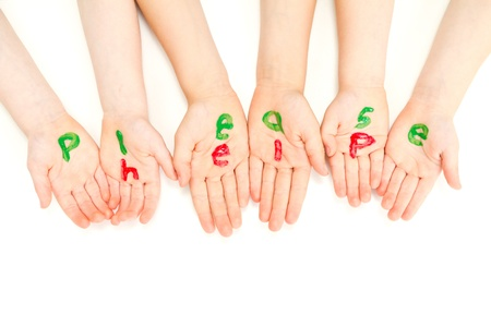 Kids hands begging and painted with the words please help