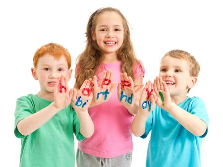 Three happy kids with happy birthday letters painted on hands  Isolated on white  photo