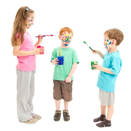 Three kids painting each other photo