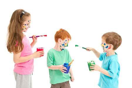 Kids painting faces on each other  Isolated on white  photo