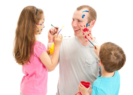 Kids painting on Dad face  Isolated on white  photo