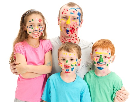 Family of kids and dad with messy painted faces  Isolated on white photo