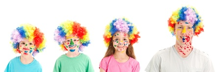 dressups: Kids and Dad with painted faces and clown wigs  Isolated on white