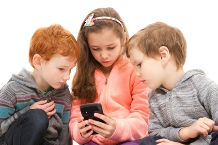 Group of kids using black smartphone. Isolated on white. photo