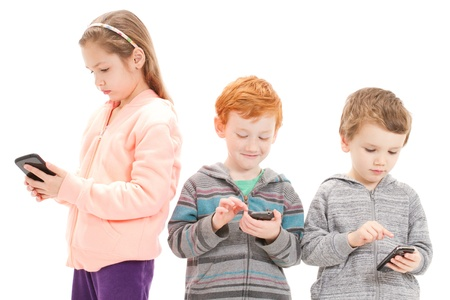 Young children using mobile phones for social media. Isolated on white.