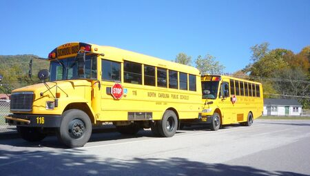 School buses outside school Stock Photo - 4144161