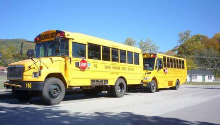 School buses outside school Stock Photo - 4144161
