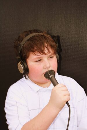 Young man singing with microphone photo