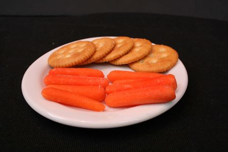 Yellow crackers and carrot sticks