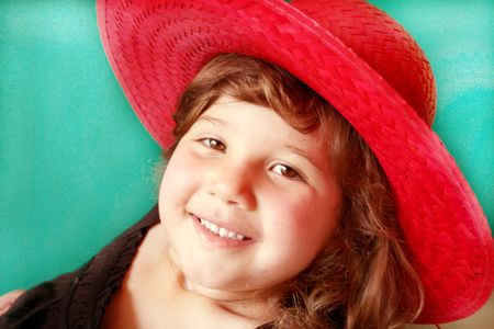 giggle: Pretty little girl in a bright red hat