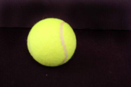 One yellow tennis ball
