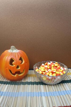 candy corn: Jack-O-Lantern with bowl of candy corn