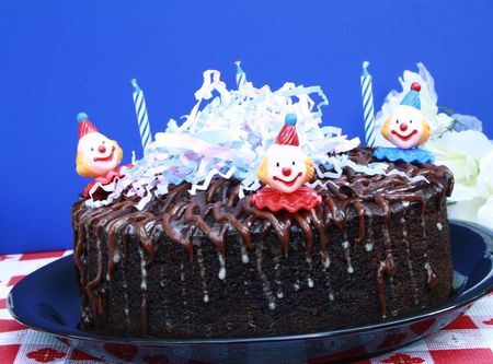 chocolaty: Chocolate birthday cake with candles and clowns with decorations