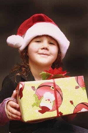wearing santa hat: Pretty little girl wearing Santa hat