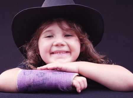 Young girl with broken arm photo