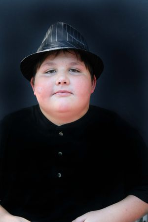 Portrait of a handsome young man in a fedora hat