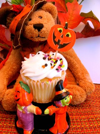 Teddy bear with cupcakes decorated for halloween photo