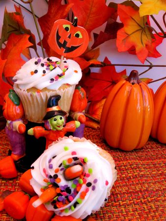 Vanilla cupcakes decorated for halloween, pumpkins with copy space photo