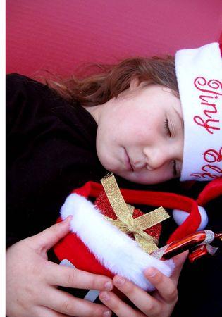 wearing santa hat: Sleeping little girl wearing santa hat Stock Photo