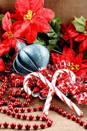 Candy canes with christmas bulb and poinsettias photo