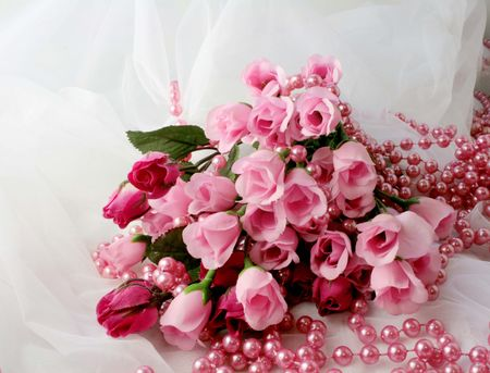 pink roses: Bunch of pink roses on white lace Stock Photo