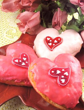 Valentine donuts with roses in background photo