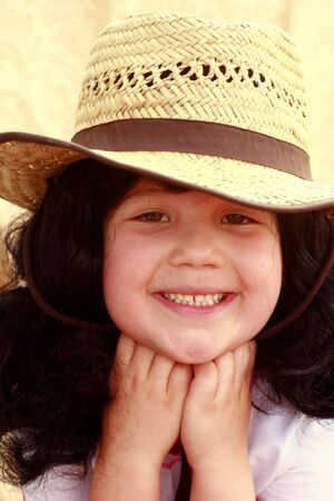 Cute child in cowboy hat, smiling photo