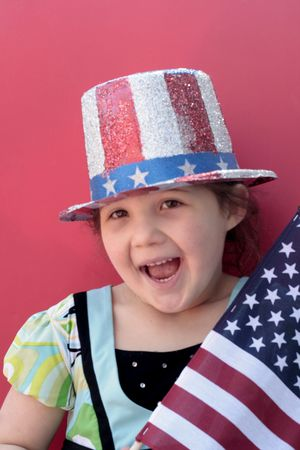 Smiling young girl with 4th of july celebration photo