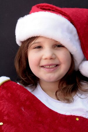 Pretty girl in santa hat and christmas stocking photo