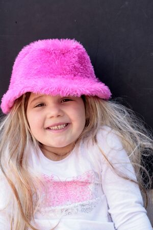 pink hat: Pretty little blond girl wearing pink hat Stock Photo