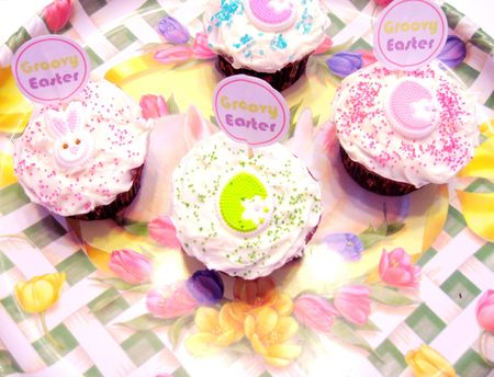 Decorated Easter cupcakes on plate photo