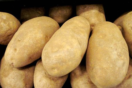 Box of fresh potatos