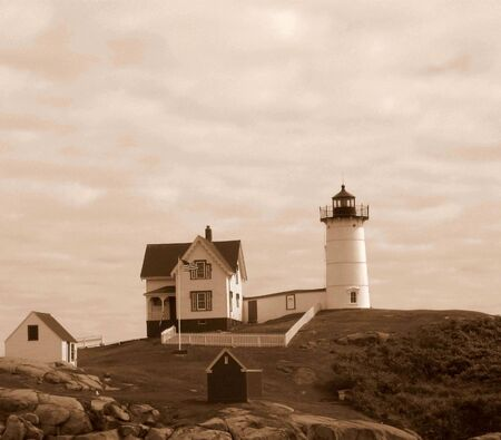 Lighthouse on the hill in sepia photo