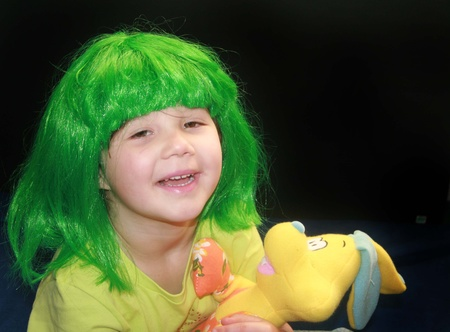 st  patty's: Little girl in green wig for St Pattys day