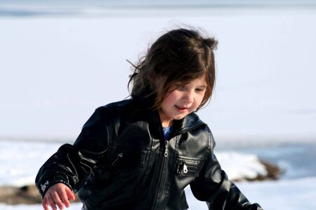 Pretty little girl in snow and ice photo
