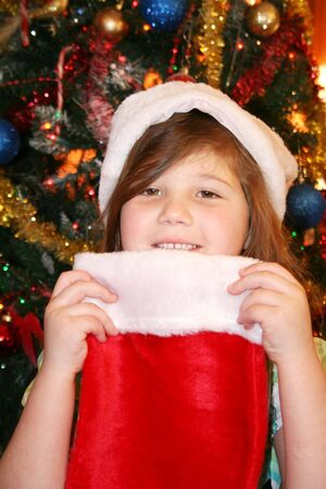 Pretty girl wearing red santa hat at Christmas Stock Photo - 8922216