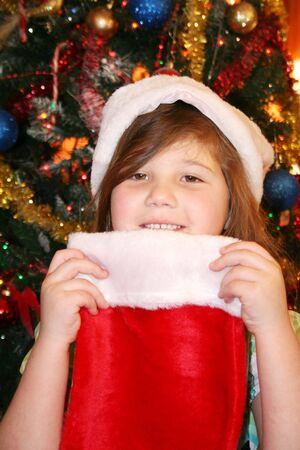 Pretty girl wearing red santa hat at Christmas Stock Photo - 8922216