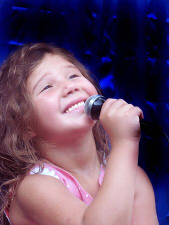 Pretty little girl singing a song photo