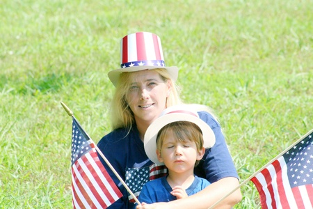 Mother and baby son with 4th of July hats photo