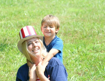 Young mother and son on 4th of July photo