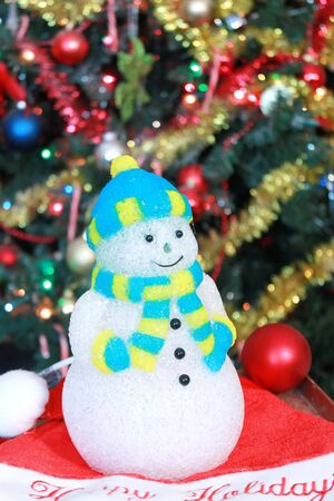 Snowman decoration under Christmas tree photo