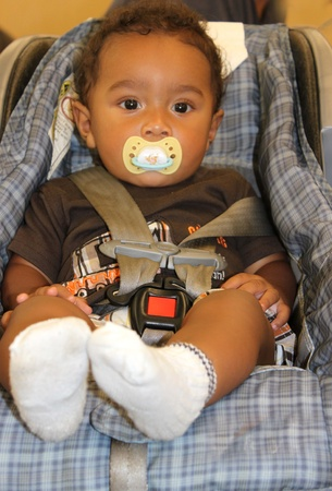 biracial: African american baby in carseat Stock Photo