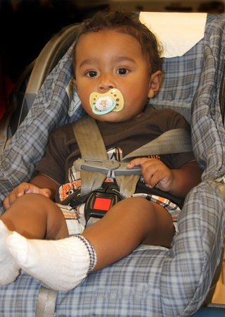mixed ethnicities: African American baby in car seat