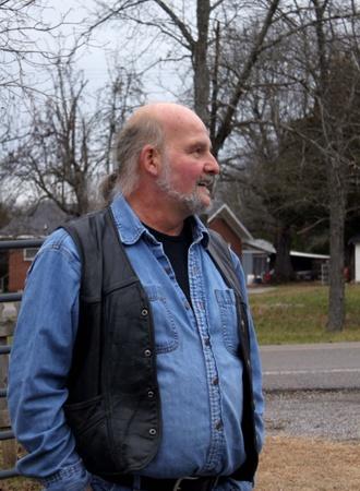 hobble: Portrait of a senior man outside