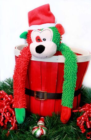 Christmas monkey in basket Stock Photo