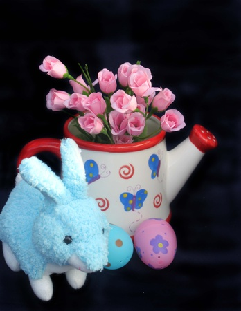 Blue Easter bunny with roses and eggs photo