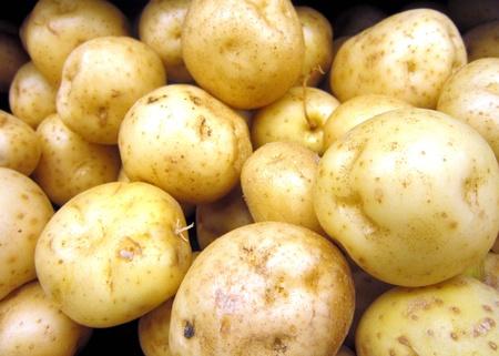Box of white potatoes Stock Photo
