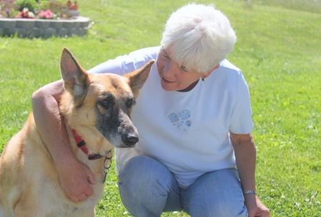 Seniior woman with her German Shepherd